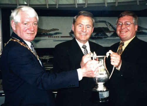 "Provost Joe Thomas and Chief Executive Alex Linkston presents the ""Loving Cup"" of the West Lothian Council to Provost Franz-Josef Leikop, June 2000"